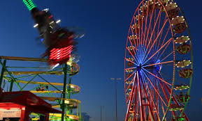 ferris wheel and other rides at night